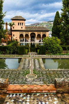The sheer red walls of the Alhambra rise from woods of cypress and elm. Inside is one of the more splendid sights of Europe, a network of lavishly decorated palaces and irrigated gardens, a World Heritage Site and the subject of scores of legends and fantasies.  Read more: http://www.lonelyplanet.com/spain/granada/sights/castles-palaces-mansions/alhambra#ixzz3CptaiWRS