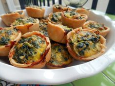These mini quiches are divine! Perfectly cooked crust, cheesy texture with hints of bacon and garlic, plus hearty spinach and a tad of heat from the red pepper flakes.