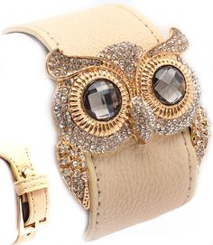 Fabulous faux leather bracelet designed like a belt with a button closure, adorned with an over-sized owl face with glass stone eyes, and pave set with crystal...