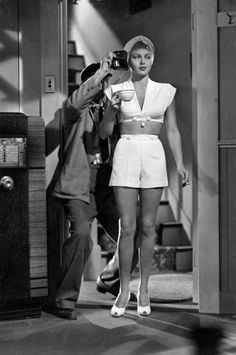 The lighting man makes a check, as Lana Turner grabs a coffee and a smoke, just before John Garfield sees her for the first time in The Postman Always Rings Twice.