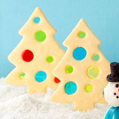 Melted hard candies give these tasty tree cookies a beautiful stained glass look. http://www.parents.com/recipe/cookies/twinkly-trees/?socsrc=pmmpin112912hocoTwinklyTrees