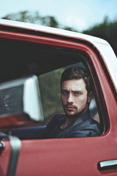 Emmet Sharp sits in his truck & stares out, his brows furrowed as he zones out in frustration...