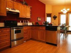 Orange Kitchens With Cherry Cabinets And Stainless Steel Appliances