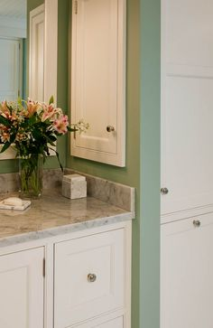 Recessed medicine cabinet beside sink for extra storage. For my master bath.