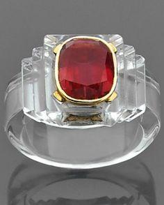 An Art Moderne rock crystal, tourmaline and gold ring, by René Boivin, circa 1937.