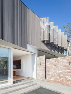 Located in Balmain, NSW, Australia and completed in This house was designed by Benn + Penna Architecture and was honoured with the NSW Architecture Awards Brick Cladding, House Cladding, Cladding Ideas, Steel Cladding, House Facades, House Exteriors, Timber Battens, Timber Screens, Privacy Screens