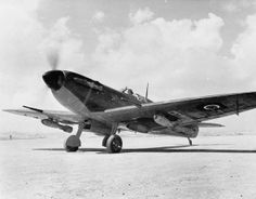 "A Supermarine Spitfire Mark VB carrying two 250-lb GP bombs on underwing shackles, prepares to take off from an airfield in North Africa. No. 152 Squadron RAF began the first use of the Spitfire as a fighter bomber in North Africa, flying ""Rhubarb"" sorties from Souk el Khemis, Tunisia, in March 1943."