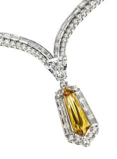 Harry Winston. Pendant adorned with a diamond-cut yellow brown kite in a circle of baguette diamonds and round cut diamond held by a shield on a necklace of 243 round diamonds and baguette. Mount in platinum and yellow gold. Signed HW (Harry Winston). Yellow brown diamond weight: 7.33 carats.