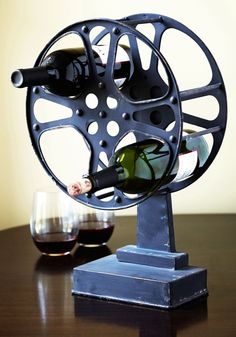 A Reel Work of Art Wine Rack. Combine your passions with this unique metal wine rack! #black #modcloth