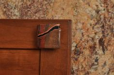 Campfire Creek - Cinnamon color with a dark grey pattern that occasionally contains red. #Bold #KitchenHardware