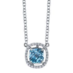 Floating blue topaz halo pendant available in white, yellow, or rose gold.
