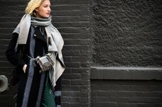 Blue and green worn together has never looked so cool. Blogger Zanita Whittington at NYFW Fall 2015 in a Tibi Pre-Fall 2015 coat and Spring 2015 Featherweight Suede Wrap Pants as seen on W Magazine. [Photo credit: Adam Katz Sinding]