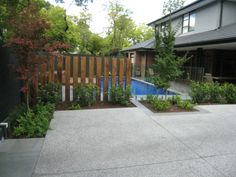 My brother's pool area completed by TLC/Scott_4_driveway is exposed aggregate ground back to smooth finish