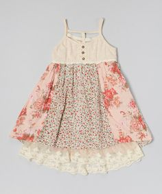 Alternating rows of blooming floral prints lay over a sheer lacy lining to create an enchanting look on this comfy dress. Fit to be twirled, this fanciful frock is topped off with darling lace-trimmed buttons and waistband.