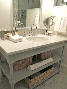 Powder vanity and marble top...would look great with dark espresso finish on base and vibrant wall covering in back.