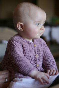 Simple lines and a cute a-line flair make this cardigan a fun knit and great for kids to wear. Knit in two directions; work the short row yoke from side to side and then work the body downwards. A unique finishing touch is added using a short row hem curve.