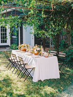 Cozy up for this gallery showcasing all the ingredients for hosting an early autumn wedding with unique, seasonal designs. From a cake with spiraled sugar ribbons to a tablescape beneath wild floral tunnel, there is nothing but magic in these fall microwedding ideas in muted spice tones. Just wait til you see the adorable spiked cider wall and mobile bubbly cart to boot! See it all on Ruffled Blog. #microweddingideas #fallweddingcolors #signaturedrinks #alfresco