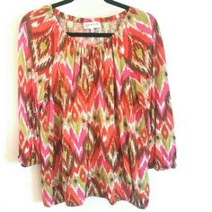 Jones New York Vivid Multicolor Ikat Print Top XL This Jones New York Sport Vivid Multicolor Ikat Print Top is a size XL in good used condition. It has a drawstring neckline and lightly elasticized bottom. Soft stretchy 100% viscose. Bust measures 22 inches across laying flat, measured from pit to pit. 27 inches long. ::: Bundle 3 + items from my closet and save 30 % off when you use the app's Bundle feature! ::: No trades. Jones New York Tops