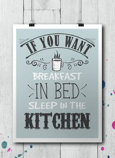 """Typography poster in tones of blue, grey and white with the message """"If you want breakfast in bed, sleep in the kitchen"""". Cool idea for decorating your kitchen walls."""