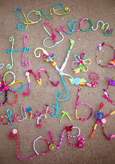 Covered wire with strips of fabric and bent it into words or letters.