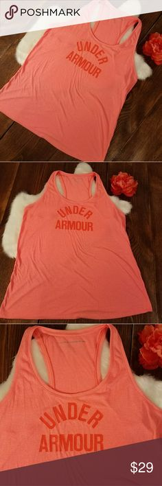 (Under Armour) Orange Exercise Tank Under Armour. Excellent used condition!  Coral Pink / Orange Exercise Tank.  **The size tag is missing  (like many athletic wear tanks, the tag is meant to be removed).  snapped flat lay measurement photos for reference  (zoom in to see them better😁). In my opinion, this is a loose fit style by Under Armour and I believe this is an XL. Under Armour Tops Tank Tops