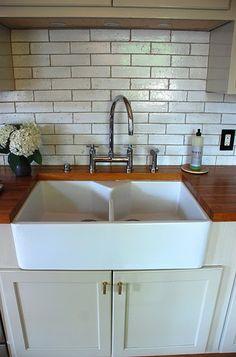 Farm Sink, butcher block counters, subway tiles