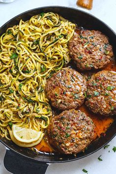Cheesy Garlic Burgers with Lemon Butter Zucchini Noodles - Rich and juicy, you'll instantly fall in love with these hamburger patties served with plenty of lemony zucchini noodles.