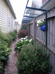 Custom cat proofing added to top of fence to keep her cats safe in her back yard! Love this! by Alana Strang