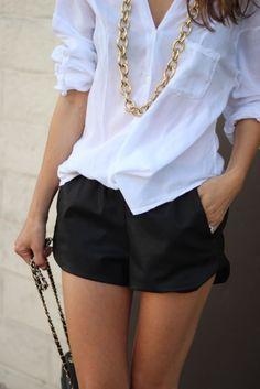 White button down blouse, black dress shorts
