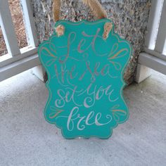 A personal favorite from my Etsy shop https://www.etsy.com/listing/223305327/wooden-scroll-sign-let-the-sea-set-your