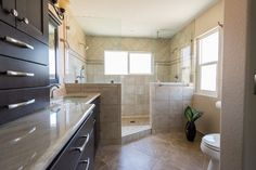 A master bathroom walk in shower with two shower areas is a unique element to add. www.choosechi.com