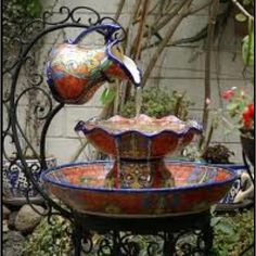 Fountain. Mexican pottery so beautiful!