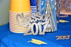 Class of 2017! Congratulations graduate! Gold glitter class of 2016 table decor for graduation party! Blue and gold party decor from www.kendollmade.com