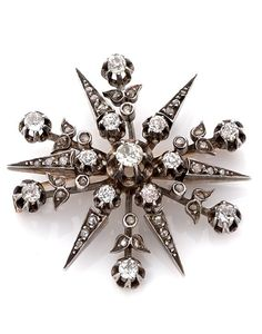 A DIAMOND, SILVER AND 18K GOLD BROOCH, CIRCA 1880. Set with old and rose cut…
