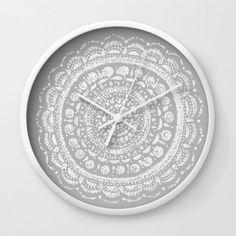 A personal favorite from my Etsy shop https://www.etsy.com/listing/491090207/mandala-wall-clock-grey-wall-clock