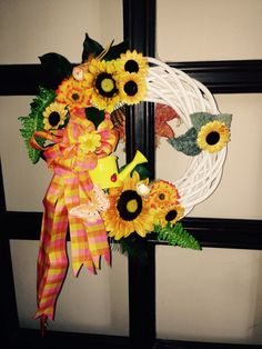 Sunflower wreath 40 cm Added sunflowers, watering can, butterflies, birds and a bow.  More at https://www.facebook.com/Moje-vence-995508700482994/