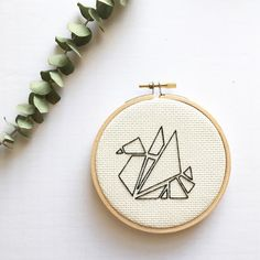 4 hoop with geometric swan design, finished with a fabric back and ready to hang