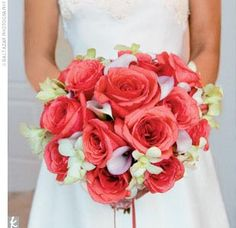 coral roses, white orchids, and light pink mini calla lilies.