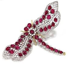Ruby and diamond dragonfly pendant-brooch, Trio. photo courtesy Sotheby's  Set with round diamonds weighing approximately 7.35 carats, additionally set with oval and pear-shaped rose-cut rubies, mounted in 18 karat white and yellow gold, signed Trio.