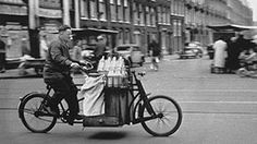 Milk and dairy product delivery by transportation bike in the 1950's in Amsterdam. Photo Eddy de Jongh. #amsterdam #1950