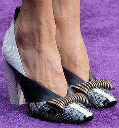 Louis Vuitton | Autumn 2018 | Mixed-media Panelled Pumps in black and white, featuring gold-tone metal-wrapped bows on the toes, worn by Jennifer Connelly in Los Angeles in April 2018 | Photo: YourNextShoes.com | April 2018