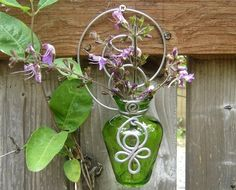 For your porch and patio or indoors too to bring some color into your house! Green Glass Celtic Spirals Hanging Wall Vase  by nicholasandfelice, $18.00