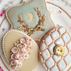 Unbelievable! These are some of THE most beautiful cookies ever. Ever! Vintage roses, quilting, laurel wreath, cameo, blue, turquoise, ivory easter egg, plaque button cookies