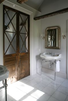 Vintage-style master bath with lovely old mirrored doors