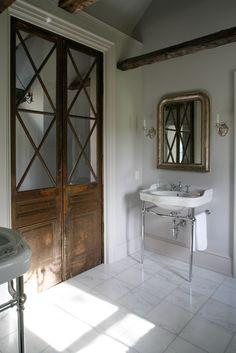 Master Bath by Tendenze Design - Love the doors, but don't like the floor tiles. Ideas Armario, Interior And Exterior, Interior Design, Farmhouse Interior, Interior Doors, Home Renovation, Bathroom Doors, White Bathroom, Pocket Doors
