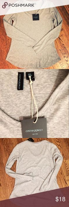 NWT Cynthia Rowley v-neck tee Awesome classic Cynthia Rowley New York V-neck long sleeve tee, size small, NEW with tag. Good length, slight side slits (~2in each side), warm gray. Made in Peru, cotton/modal blend with 4% elastane. Soft, easy fit, perfect for anything! Love!! Cynthia Rowley Tops Tees - Long Sleeve