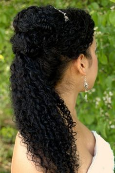 cascading bun and ponytail updo, puerto rican bride, curly bridal hairstyle. natural hair upo
