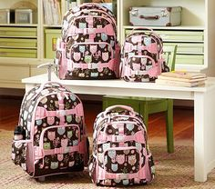 Mackenzie Chocolate Owl Backpacks   These wide-eyed and winking owls know it's wise to keep organized for school. Our rugged and roomy backpacks have lots of pockets, exterior straps and gear loops that keep everything in place. Made from rugged, water-resistant 600-denier polyester.   Large and Rolling hold a lunch bag, 1 large notebook, 2 small notebooks, several books, and a water bottle.