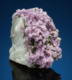 a gorgeous specimen of Lepidolite with Green Elbite (tourmaline) crystals.