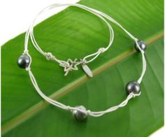Tahitian pearls with white leather  www.pearlinc.nl